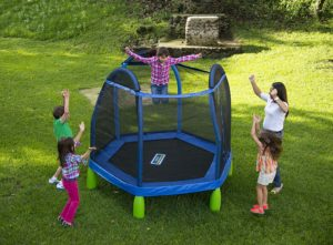 Children jumping on first trampoline